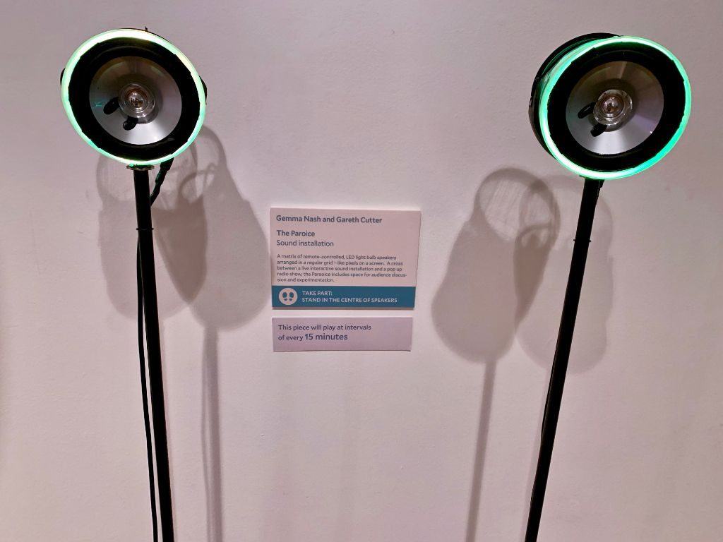 Two LED speakers on stands.